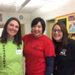 Picture of three MCEDD staff membersvolunteering at Robotics Tournaments