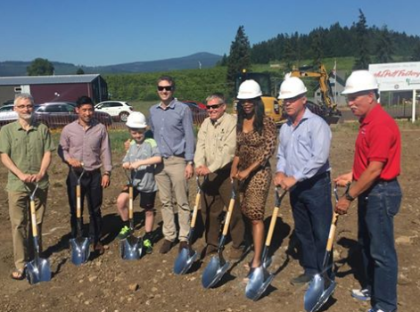 Individuals with shovels gather for the Know Your Fruit facility groundbreaking