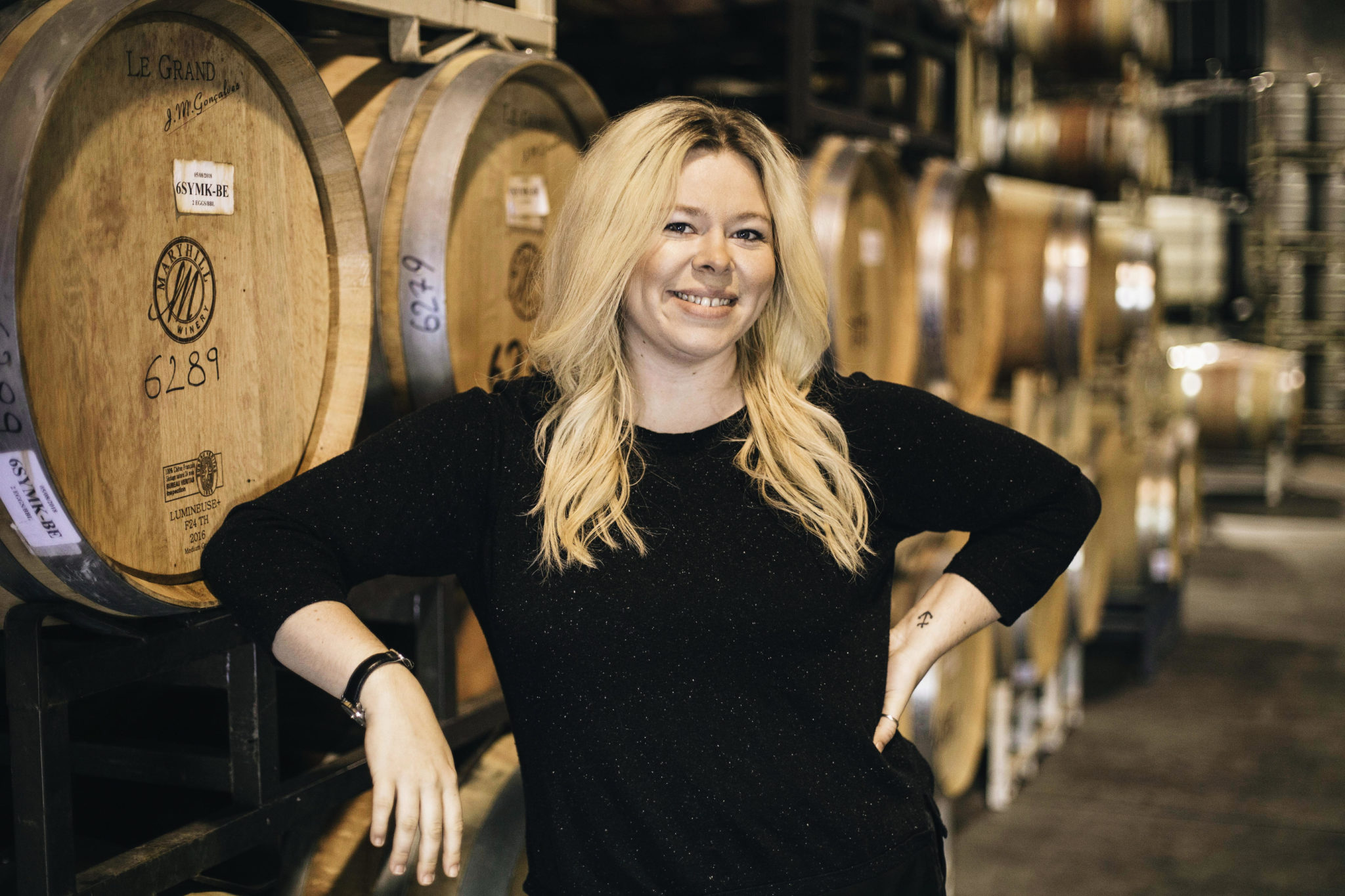 Cassie Courtney in front of Maryhill Winery barrels