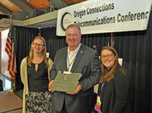 Amanda Hoey and Carrie Pipinich accept award for regional broadband strategies
