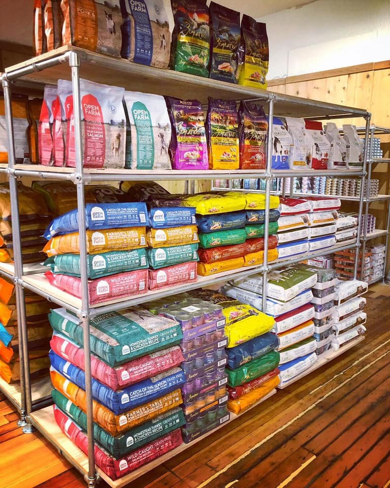 Interior of Dog River Pet Supplies; stacks of pet food on shelves