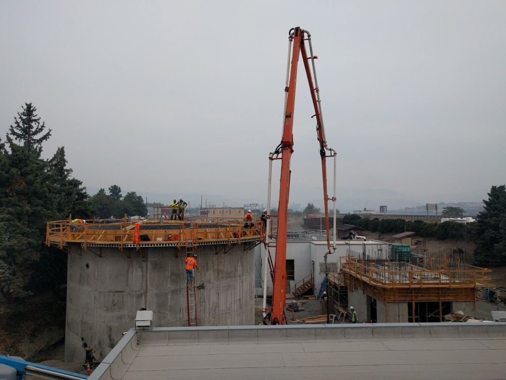 Crane and workers at The Dalles Wastewater plant