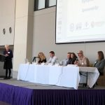 Panelists speak at the symposium