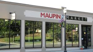 Building with sign that reads Maupin Market